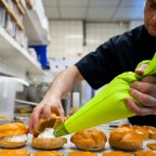Dutch confectioner Arnold Cornelis makes orange pastries in his bakery on April 11, 2013 in Amsterdam, The Netherlands. Queen Beatrix announced on January 28, 2013 that she will abdicate and hand over the throne to Crown Prince Willem-Alexander on April 30. AFP PHOTO /ANP / REMKO DE WAAL netherlands out - belgium out        (Photo credit should read REMKO DE WAAL/AFP/Getty Images)